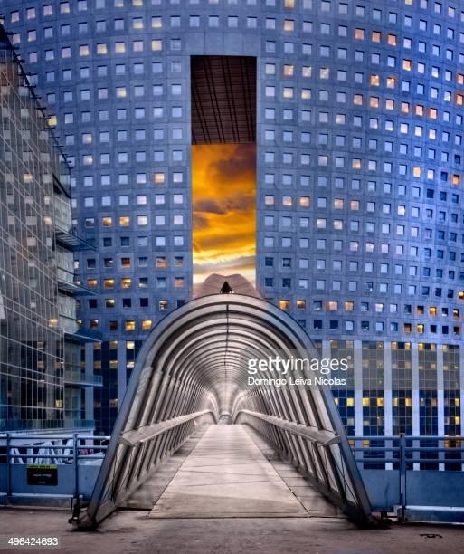 CONTENT] Pedestrian bridge with glass dome in La Defense Paris