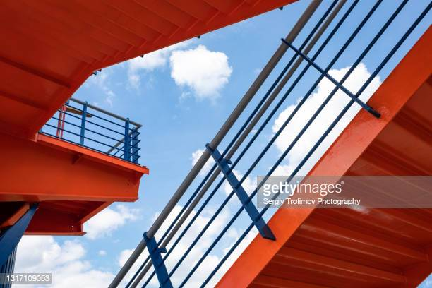 pedestrian bridge with steps in city - staircase stock pictures, royalty-free photos & images