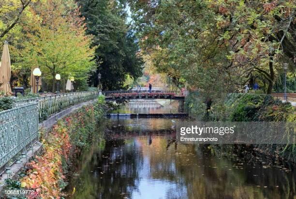 pedestrian bridges across the creek in baden baden. - emreturanphoto stock pictures, royalty-free photos & images