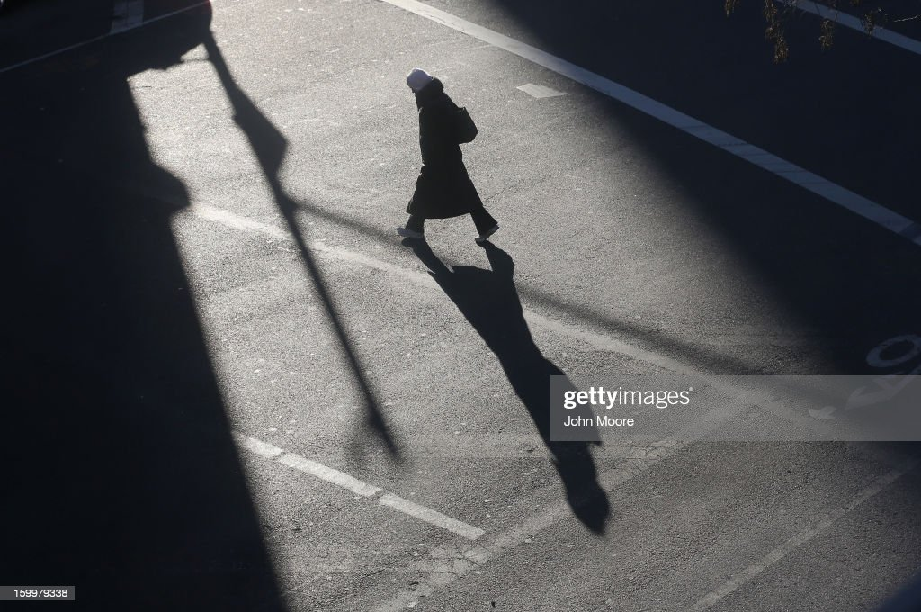 A pedestrian bundled up against the cold walks through the streets of Manhattan on January 24, 2013 in New York City. Polar air settled in over the northwest U.S. Wednesday, with temperatures in the teens and twenties.