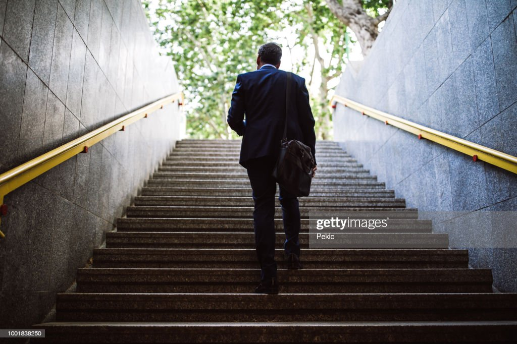 Pedestrian Businessman Walking Out Of Metro : Stock Photo