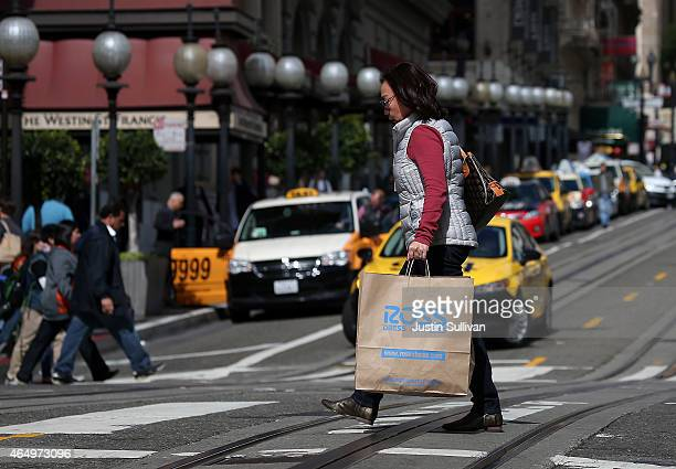 Pedestrian carries a Ross Dress For Less shopping bag on March 2, 2015 in San Francisco, California. According to a Commerce Department report,...