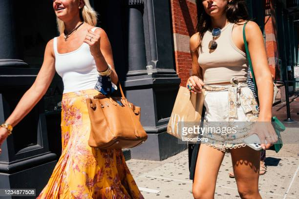 Pedestrian carries a Zara shopping bag in the SoHo neighborhood of New York, U.S., on Wednesday, Aug. 25, 2021. Consumer spending in the second...