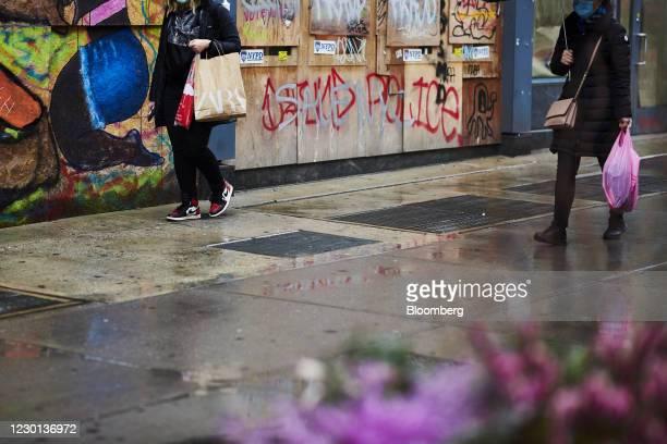 Pedestrian carries a Zara shopping bag while walking in the SoHo neighborhood of New York, U.S., on Monday, Dec. 14, 2020. The U.S. Census Bureau is...