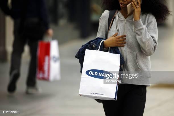 0cc9a2b3a4c A pedestrian carries an Old Navy Inc shopping bag on the Third Street  Promenade in Santa