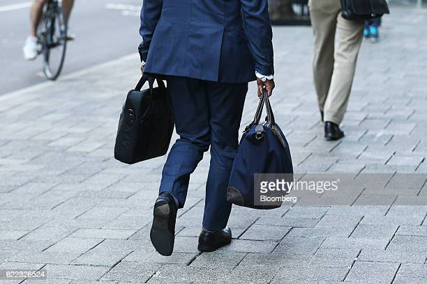 A pedestrian carries bags while walking in the central business district of Perth Australia on Friday Oct 28 2016 Australian bonds tumbled sending...