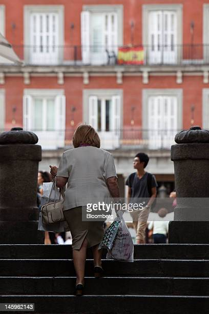 A pedestrian carries her shopping up a flight of steps in Madrid Spain on Friday June 8 2012 Spain is poised to become the fourth of the 17 euroarea...