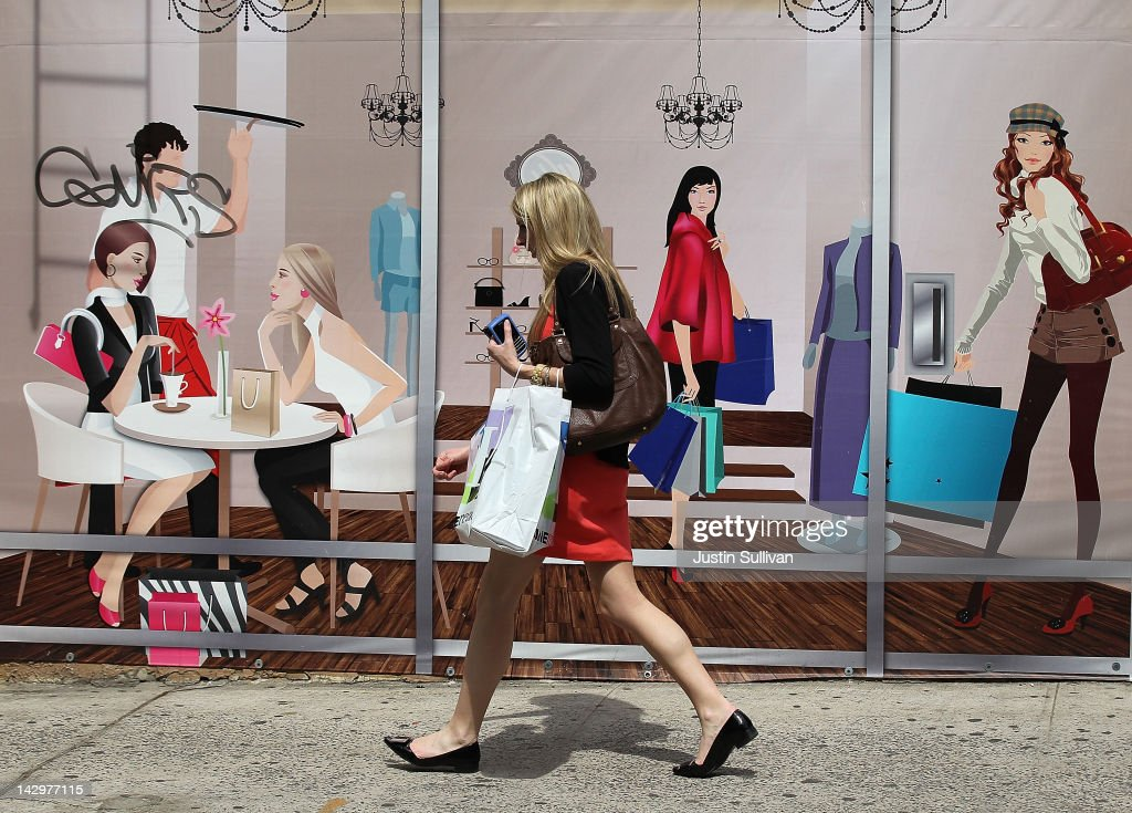 A pedestrian carrying a shopping bag walks by a mural with a shopping theme on April 16, 2012 in New York City. Despite high energy prices, the Commerce Department reported today that retail sales beat expectations in March with an 0.8 percent rise compared to a 1.0 percent increase in February.