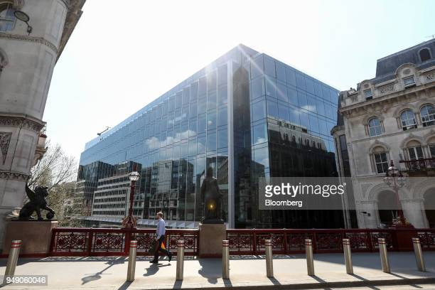 A pedestrian crosses a bridge in view of the new European headquarters of Goldman Sachs Group Inc in London UK on Friday April 20 2018 Foreign...