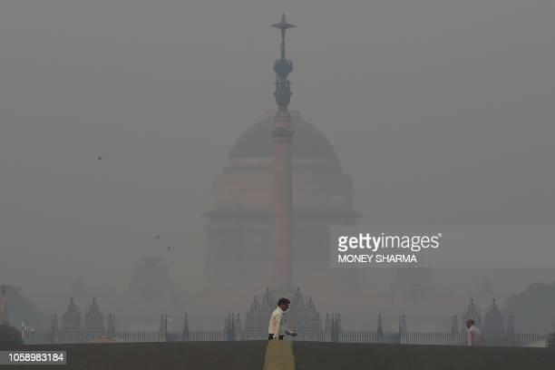 TOPSHOT A pedestrian crosses a road near the Indian President's house amid heavy smog in New Delhi on November 8 2018 Air pollution in New Delhi hit...