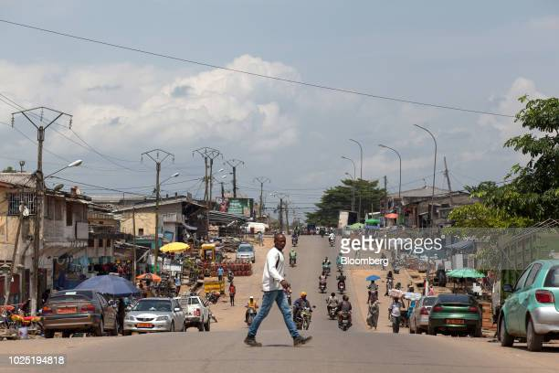 Pedestrian crosses a street in downtown Kribi, Cameroon, on Thursday, Aug. 2, 2018. Since the initial agreement to build the port at Kribi was signed...
