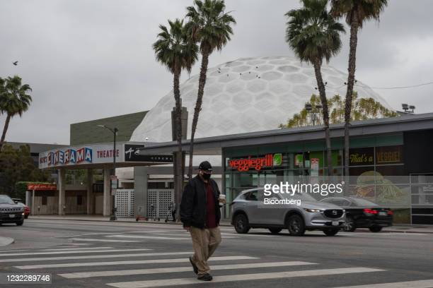 Pedestrian crosses a street in front of the Pacific Theatres' Cinerama Dome, part of the ArcLight Hollywood complex, permanently closed in Hollywood,...