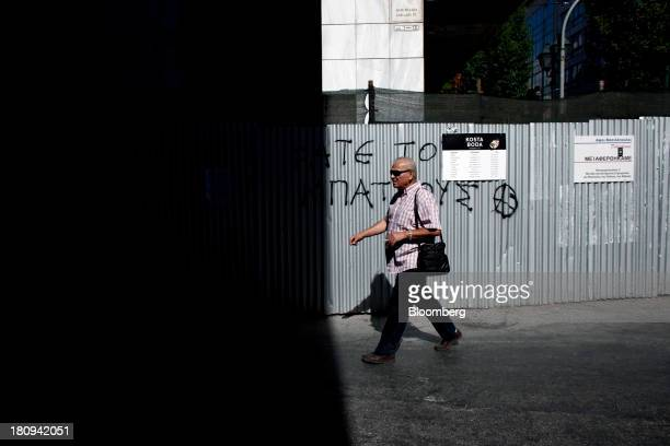 A pedestrian crosses an empty highway ahead of a demonstration to mark the start of a 48hour strike by Greece's biggest publicsector union ADEDY in...