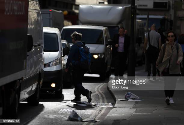 A pedestrian crosses between standing traffic in London UK on Monday April 10 2017 London has missed by seven years legal deadlines to improve air...
