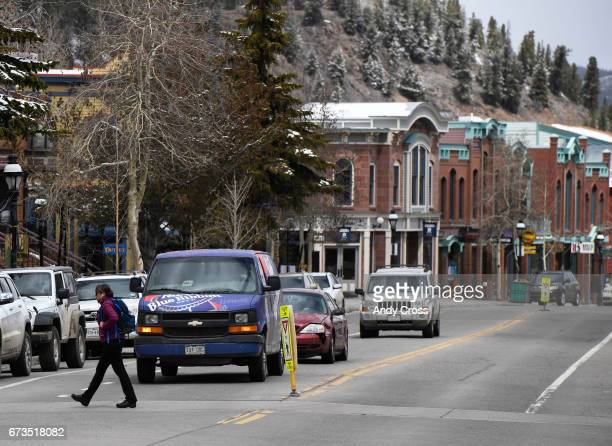 A pedestrian crosses Main St in April 26 2017 in Breckenridge Colorado