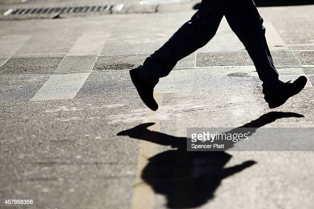 A pedestrian crosses the intersection of 3rd Avenue and 14th Street one of Manhattan's most dangerous crosswalks for pedestrians on October 27 2014...