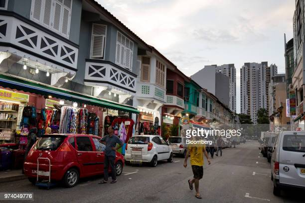A pedestrian crosses the road in the Little India area of Singapore on Wednesday June 13 2018 Tourism as well as the consumer sector will likely see...