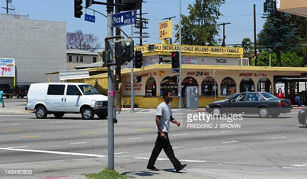 A pedestrian crosses the street at the intersection of Pico and La Brea in Los Angeles on April 27 2012 in California ahead of the 20th anniversary...