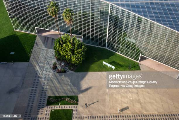 Pedestrian crosses the walkway between the Crystal Cathedral at the Tower of Hope at Christ Cathedral in Garden Grove. ///ADDITIONAL INFORMATION:...