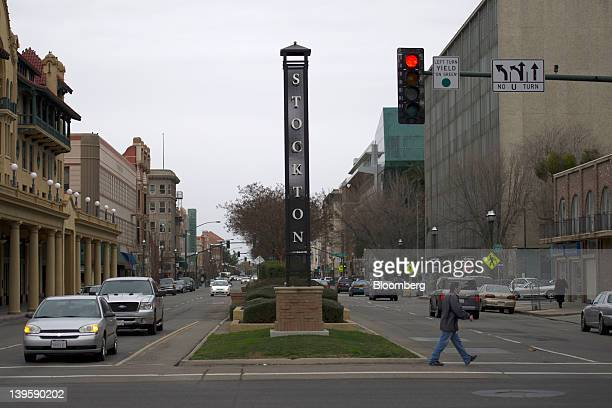 Pedestrian crosses Weber Street in Stockton California, U.S., on Tuesday, Feb. 7, 2012. The beleaguered city of Stockton, about 80 miles east of San...