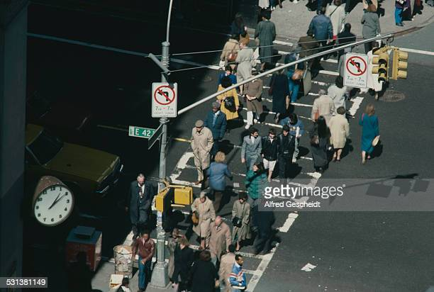 A pedestrian crossing on the corner of East 42nd Street and Madison Avenue in New York City circa 1985