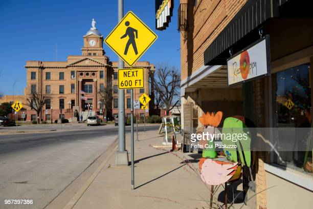 pedestrian crossing sign at downtown anson, texas, usa - pedestrian crossing sign stock photos and pictures