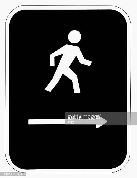 pedestrian crossing sign with arrow on bottom - pedestrian crossing sign stock photos and pictures