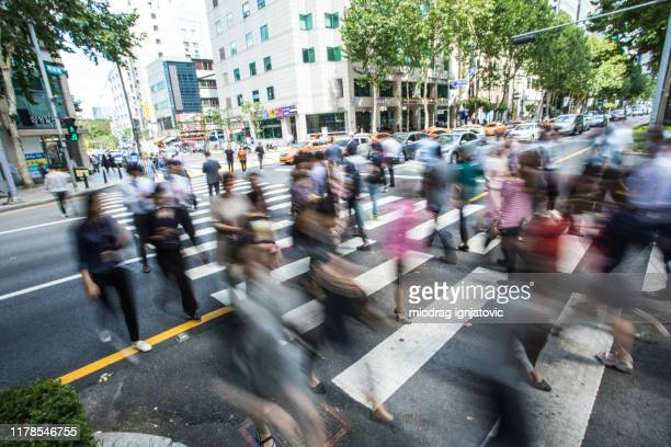pedestrian crossing street in seoul - pedestrian zone stock pictures, royalty-free photos & images