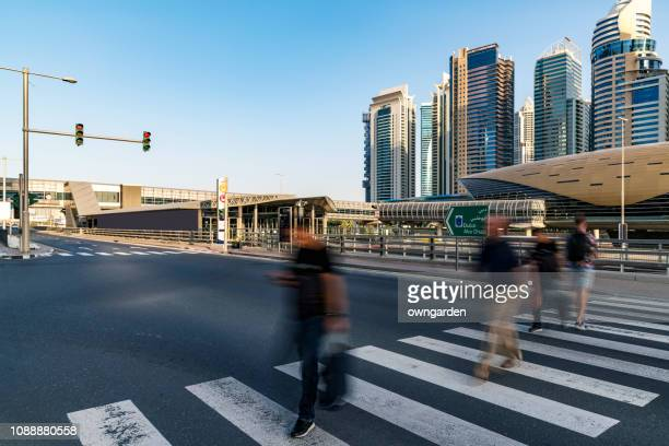 pedestrian crossing the sidewalk - pedestrian stock pictures, royalty-free photos & images