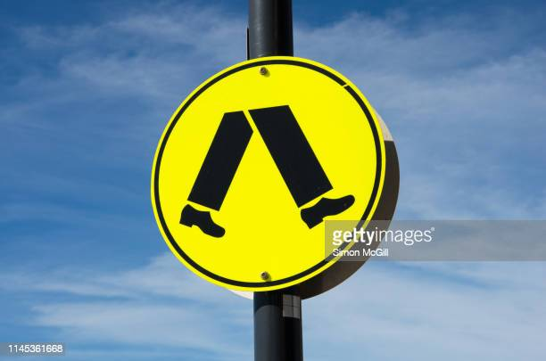 pedestrian crossing warning sign - pedestrian crossing sign stock photos and pictures