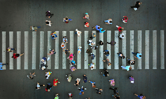 Pedestrian crowd crossing crosswalk, top view. 1143439048