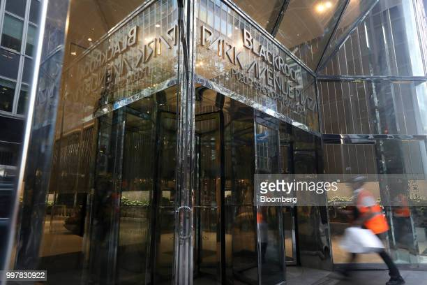 A pedestrian enters BlackRock Park Avenue Plaza in New York US on Wednesday June 11 2018 BlackRock Inc is scheduled to release earnings figures on...