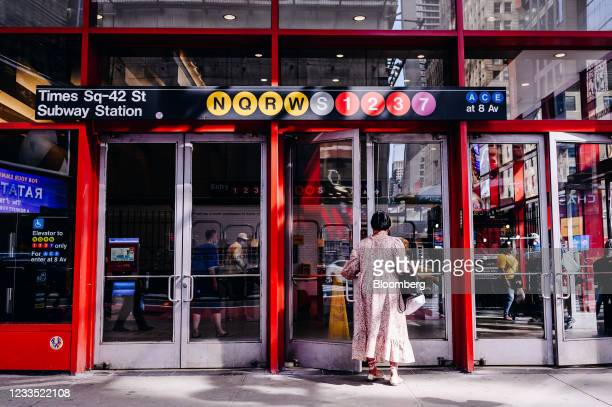 Pedestrian enters the subway in Times Square in New York, U.S., on Monday, June 14, 2021. On Tuesday, Governor Andrew Cuomo lifted New York states...