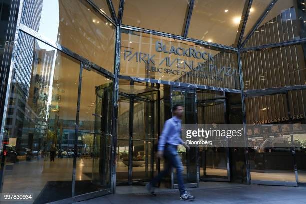 A pedestrian exits BlackRock Park Avenue Plaza in New York US on Wednesday June 11 2018 BlackRock Inc is scheduled to release earnings figures on...