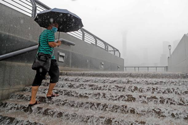 CHN: Heavy Downpours Hit Parts Of China