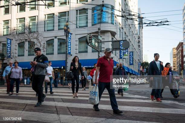 Pedestrian holds a Ross Stores Inc. Shopping bag while crossing Market Street in San Francisco, California, U.S., on Wednesday, Feb. 26, 2020. Ross...