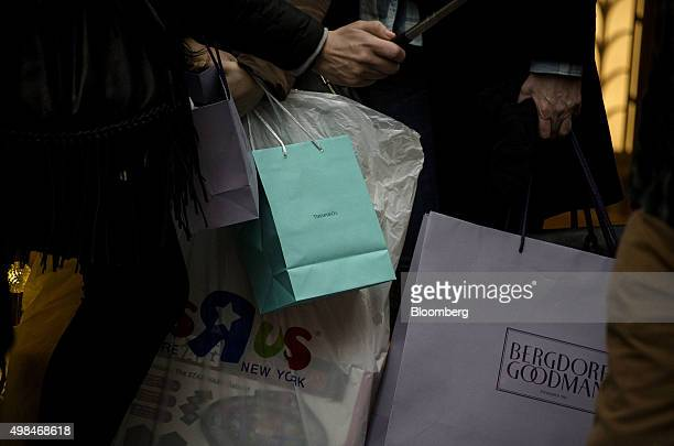 A pedestrian holds a Tiffany Co shopping bag in New York US on Sunday Nov 22 2015 Tiffany Co is scheduled to report earnings figures on November 24...