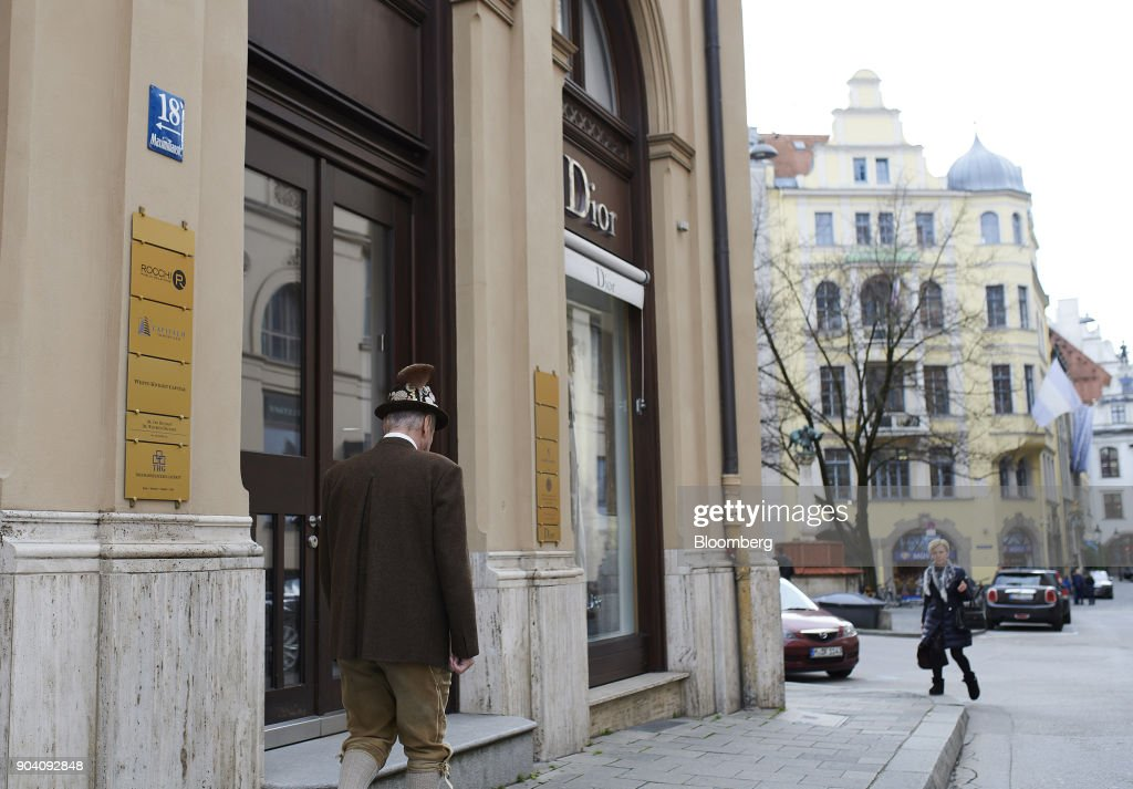 A pedestrian in traditional Bavarian attire passes a Christian Dior SE luxury clothing store in Munich, Germany, on Tuesday, Jan. 9, 2018. The German economy's solid 2017 performance extended into the final three months of the year, with growth of about half a percent. Photographer: Dominik Osswald/Bloomberg via Getty Images