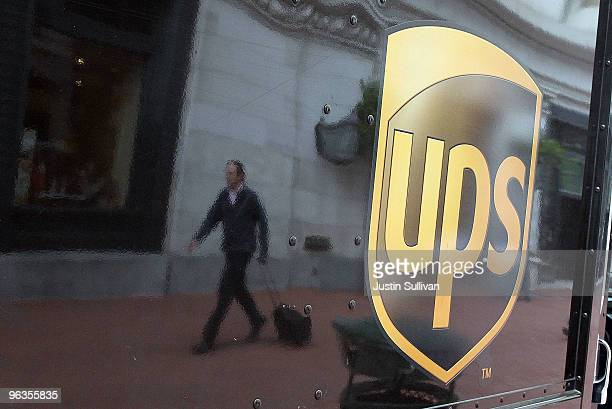 A pedestrian is reflected in the side of a United Parcel Service truck February 2 2010 in San Francisco California UPS reported a surge in...