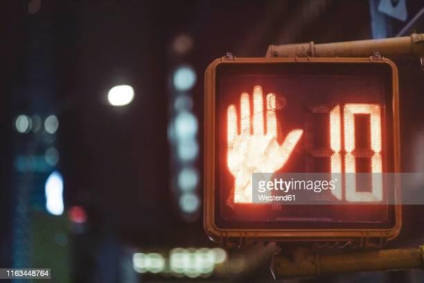 pedestrian light at night, manhattan, new york city, usa - walk don't walk signal stock pictures, royalty-free photos & images