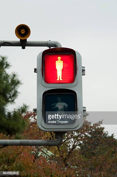 pedestrian light on red - road signal stock pictures, royalty-free photos & images
