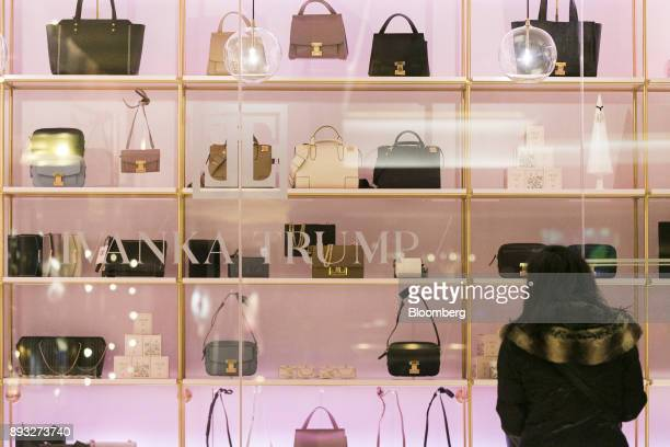A pedestrian looks at handbags on display from outside an Ivanka Trump brand store at Trump Tower in New York US on Thursday Dec 14 2017 Trump's new...