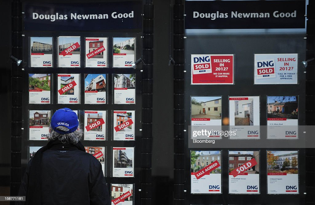 A pedestrian looks at residential property listings in the window of an estate agents in Dublin, Ireland, on Thursday, Dec. 27, 2012. Ireland will take over the EU presidency in January as the euro-area wrestles with putting the European Central Bank in charge of lenders within the currency union and other participating nations. Photographer: Aidan Crawley/Bloomberg via Getty Images
