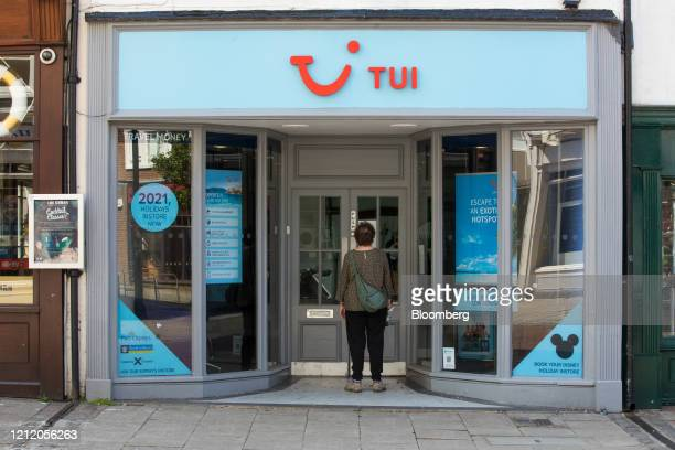 Pedestrian looks in the window of a closed travel agency store, operated by Tui AG, in Canterbury, U.K., on Wednesday, May 6, 2020. Lockdown...