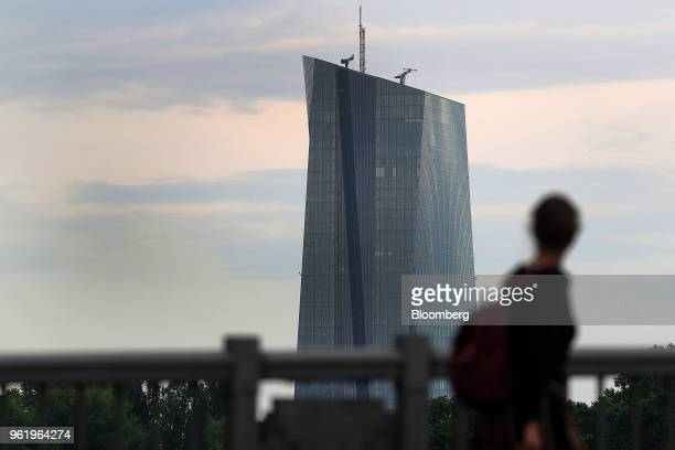 A pedestrian looks towards the European Central Bank skyscraper headquarters in Frankfurt Germany on Wednesday May 23 2018 Frankfurt has emerged as...