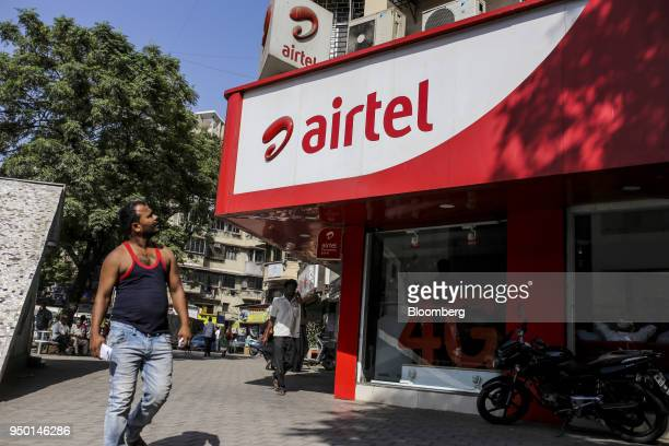 A pedestrian looks up while walking past a Bharti Airtel Ltd store in Mumbai India on Saturday April 21 2018 Bharti Airtel are scheduled to release...