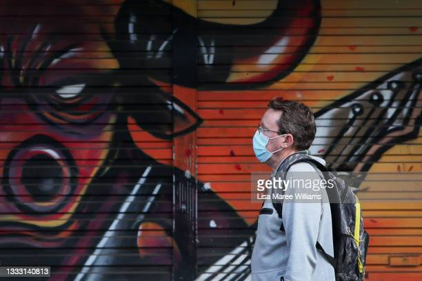 Pedestrian moves past a closed shop front along High Street in Penrith on August 09, 2021 in Sydney, Australia. Restrictions for the suburbs of...