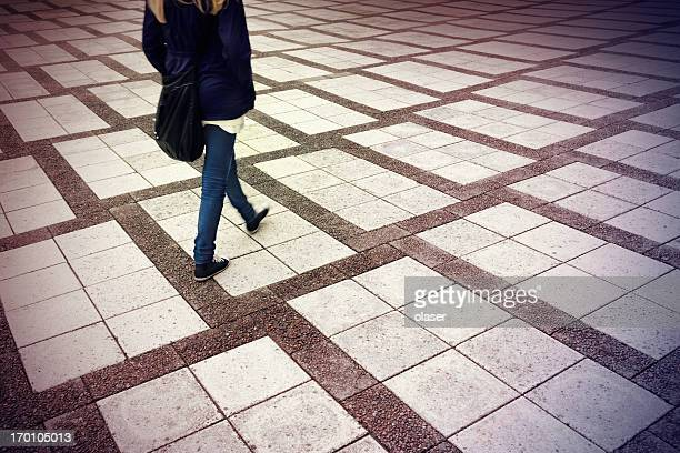 Pedestrian on tiled square