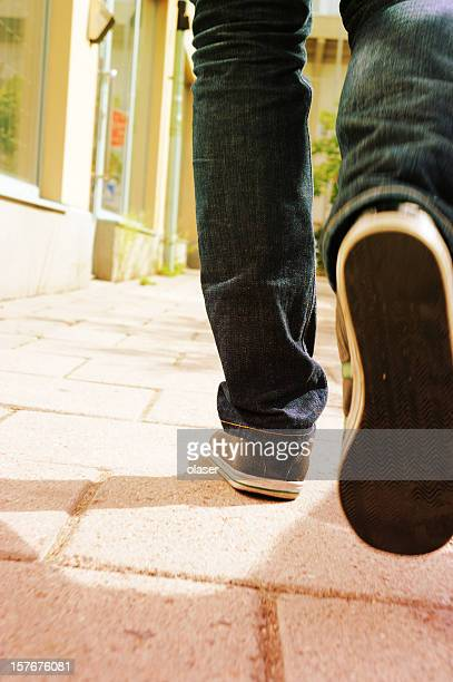 Pedestrian on tiled street
