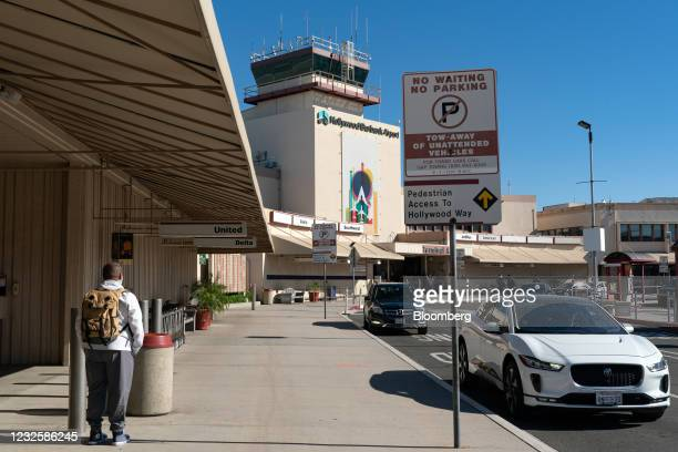 Pedestrian outside Hollywood Burbank Airport in Burbank, California, U.S., on Wednesday, April 28, 2021. New money is flowing to low-cost airlines in...
